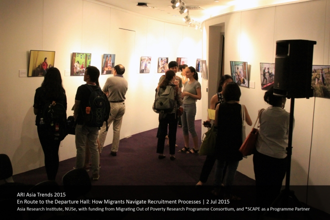 A diverse crowd checks out Ruom's photo exhibition of domestic worker stories at the Asia Research Institute's Asia Trends event, 'En Route to the Departure Hall'.
