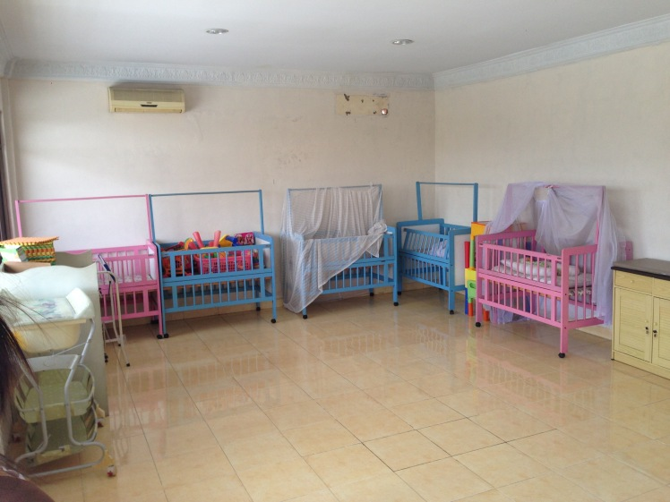 Many training centers have set-ups similar to this -- rooms that contain several beds, toilets, living room sets or child cribs, to train women to perform household chores in homes which may use different appliances or have different configurations.