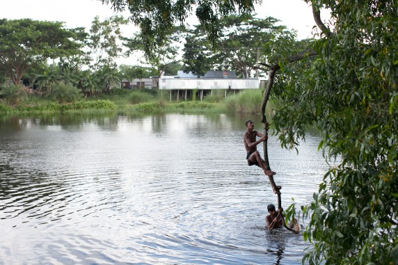 Village boys take turns to perform diving stunts at a pond near the J.C. Bose Institute.