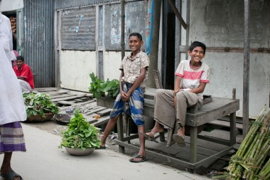 Boys selling vegetables at Tekka Market.